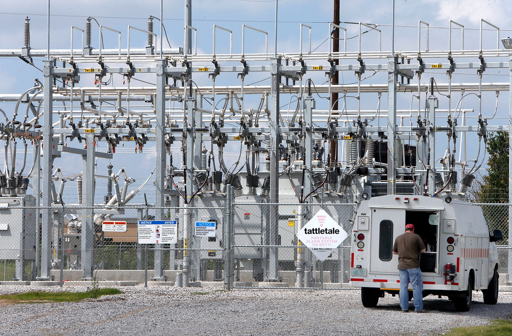 A workman prepares to work at a PSO substation in south Tulsa.  While retail residential electricity prices in the first half of this year nationwide increased 3.2 percent compared to last year, prices in Oklahoma barely rose at all.