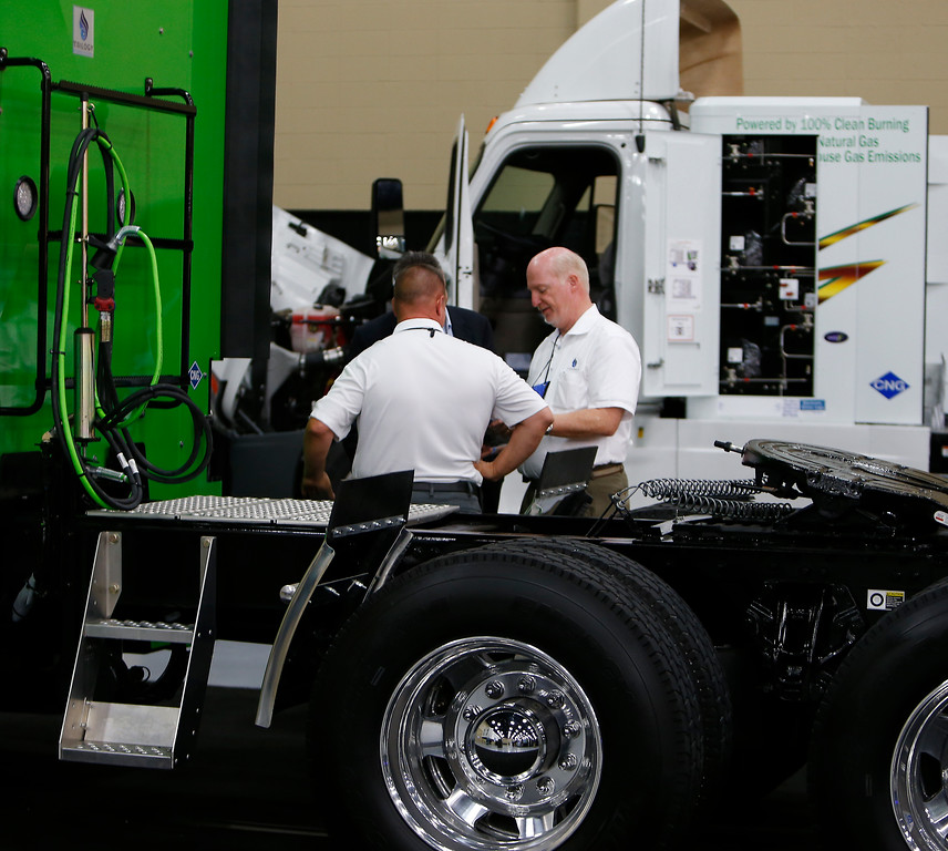 Jim Rike and Gary Gibb of Trilogy Engineered Solutions chat with a potential customer at the NGVOK Summit in Tulsa.