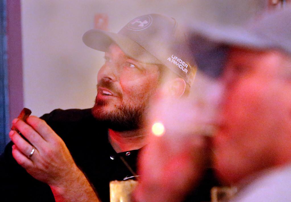 Doug Pyrak and Sly Naud relax at the Cigar Box in south Tulsa.