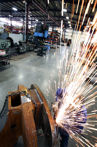 Sawyer Manufacturing Co. employee Josh Sparks works on a product for export involving the company's pipeline construction equipment.
