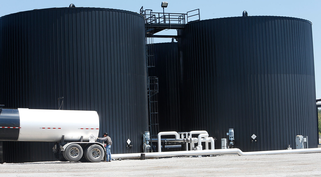 A workman loads a truck at the Asphalt Fuel Transpor terminal in West Tulsa.