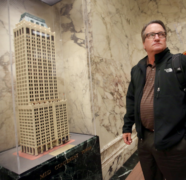 Terry Argue, stands next to a model of Tulsa's Mid-continent building.