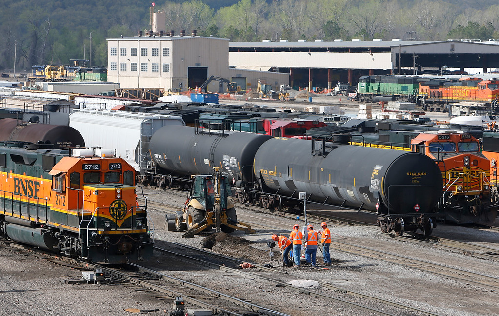 A repair crew works on a switch at the BNSF railroad yard near downtown Tulsa.