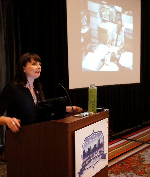 Tulsa Foundation for Architecture Executive Director Amanda DeCort gives a presentation at the  BOMA conference on historic tax credits and the role they played in downtown Tulsa's redevelopment.