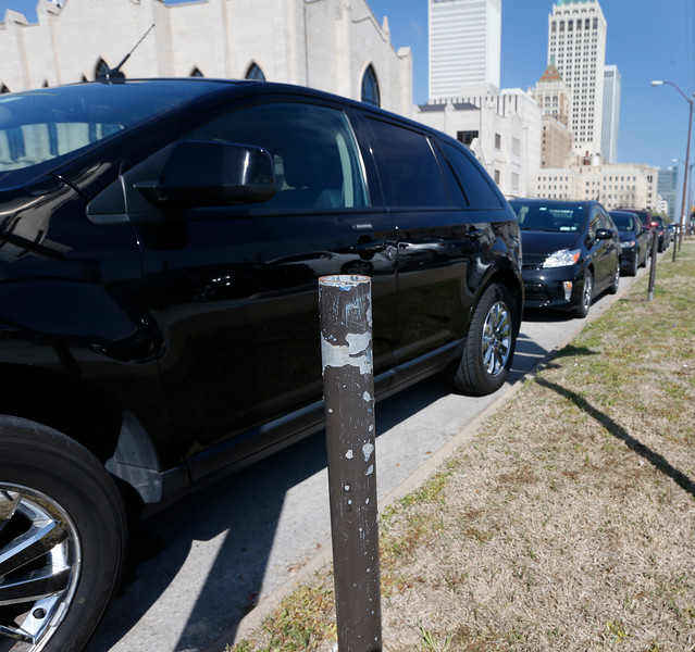 Cars line an area of downtown Tulsa where parking meters have been removed.