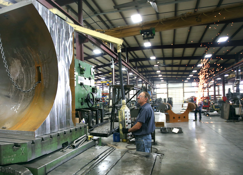Sawyer Manufacturing Co. employee Kenny Tutor and Josh Sparks work on a product for export involving the company's pipeline construction equipment.