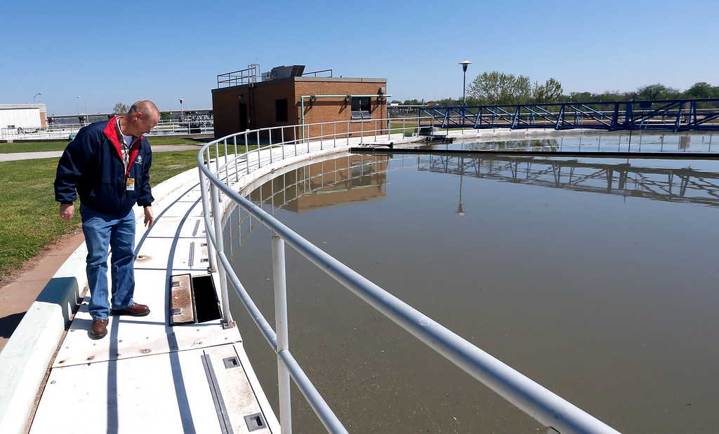 Matt Vaughan, Water Pollution Control Manager for the City of Tulsa, inspects a settlement pond at the water treatment facility on the Arkansas River.