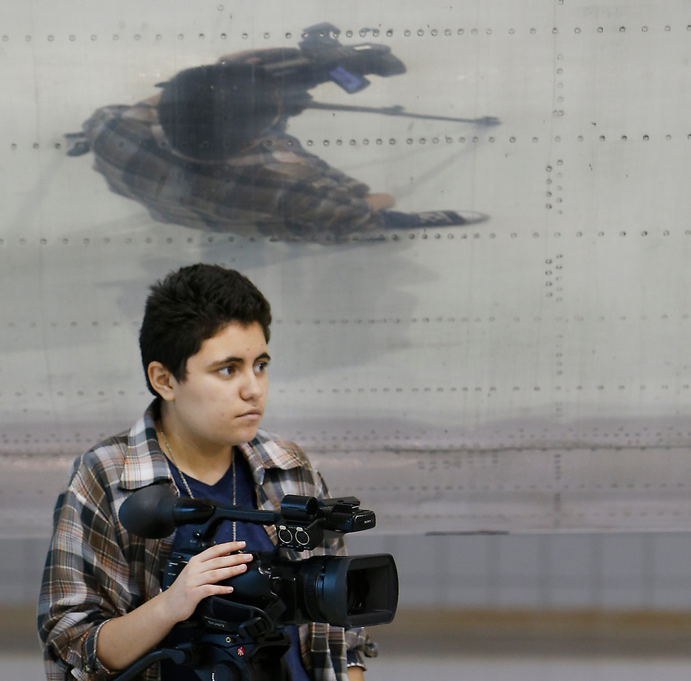 Student journalist Mika Guerra is reflected by the body of an American Airlines aircraft during a press conference announcing the new Tulsa Tech Aerospace Academy course to be offered at the Tulsa Tech Riverside Campus in the Fall.