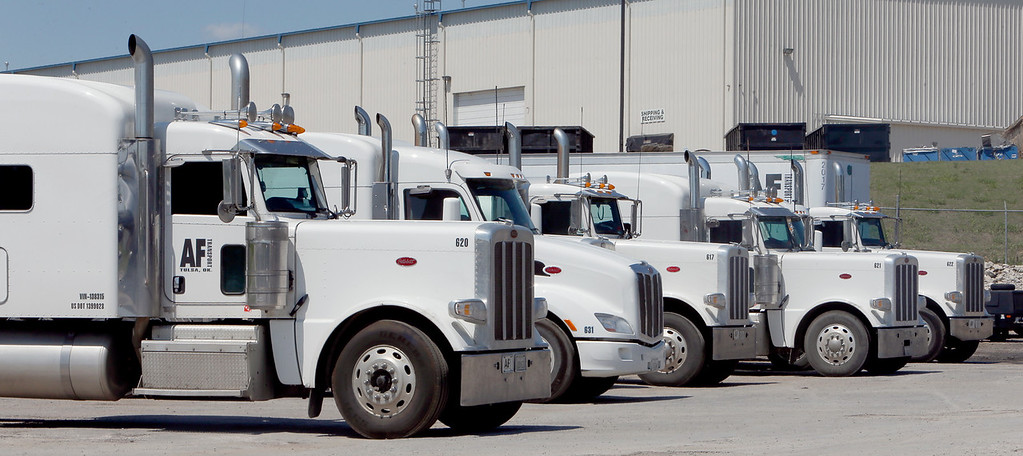 A line of trucks stand ready at the Asphalt Fuel Transpor terminal in West Tulsa.