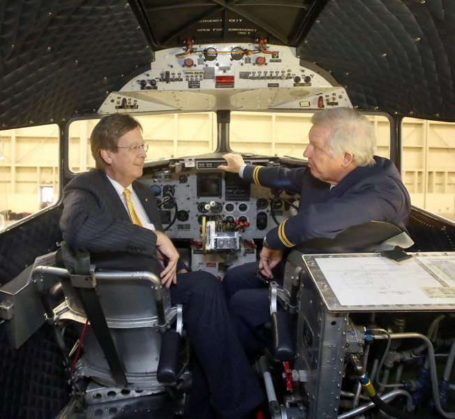 Tulsa Mayor Dewey Bartlett and Zane Lemon, President of the Flagship Detroit Foundation, sit in the cockpit of the DC3 aircraft which is currently undergoing repairs at the American Airlines maintenance base in Tulsa.