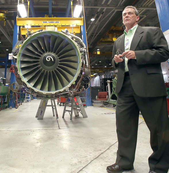 Wayne Thomas, Director of Engine Maintenance stands next to an engine undergoing an overhaul at the American Airlines maintenance base in Tulsa.