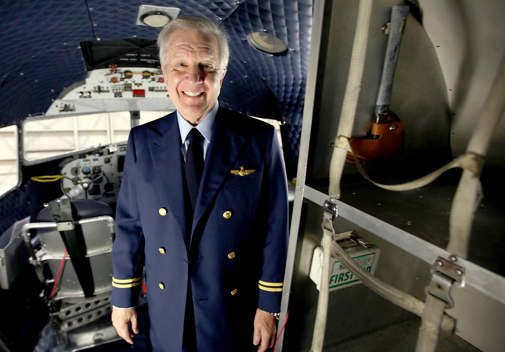 Zane Lemon, President of the Flagship Detroit Foundation, pauses for a photo in the cockpit of the DC3 aircraft which is currently undergoing repairs at the American Airlines maintenance base in Tulsa.