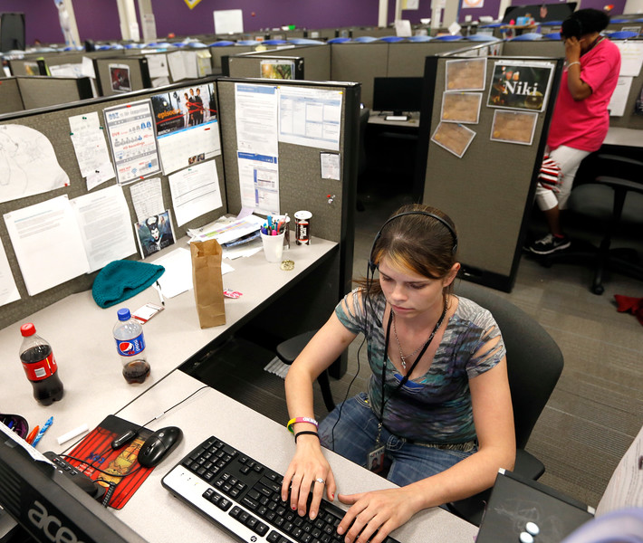 Call center employees at Sitel Corporation in Bartlesville.<br /> <br /> Sorry no ID's - left my reporters pad at the place