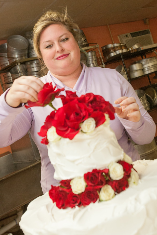 Bridgette Close decorating a cake at Nicolettes Cafe and Raspberries n Cream at 2925 Lakeside Circle in Oklahoma City.