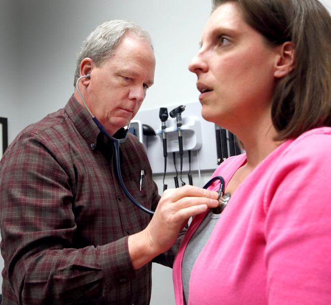 Dr Daniel Studdart examines a patient at the Imwell Health Clinic in Broken arrow.