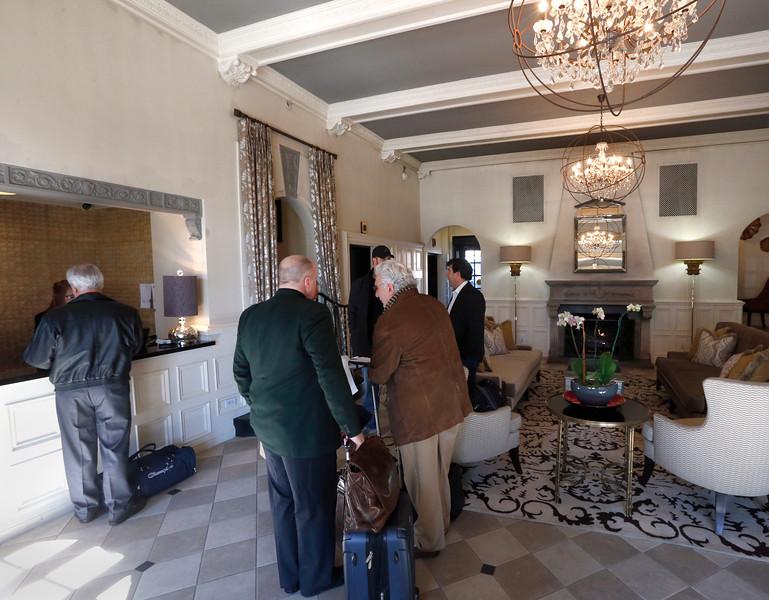 Guest check into The Ambassador hotel in Tulsa.