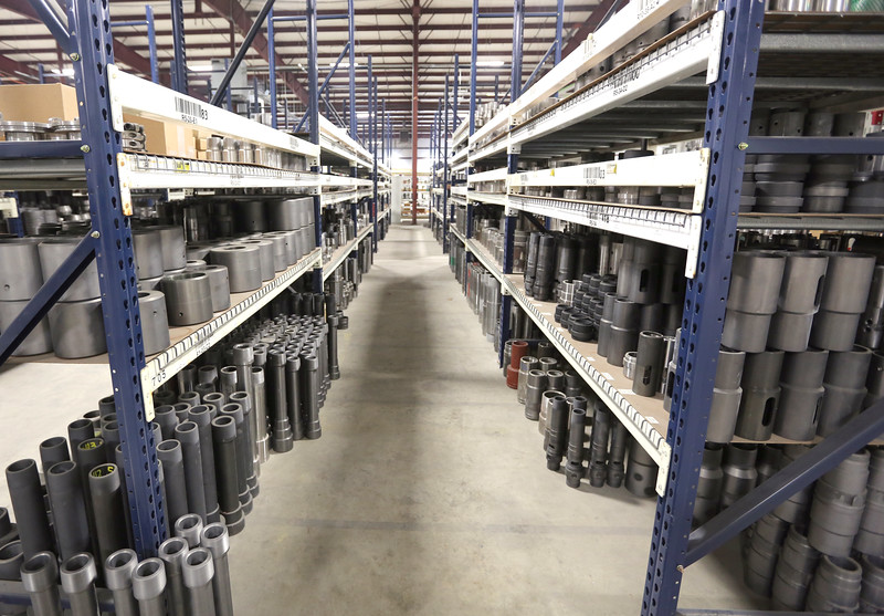 Machined oilfield tool parts sit on shelves at the Kline Tools warehouse in Tulsa.