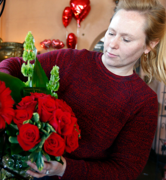 Rebecca Parks straightens a flower arrangement at Mrs. DeHaven's Flower Shop in downtown Tulsa.