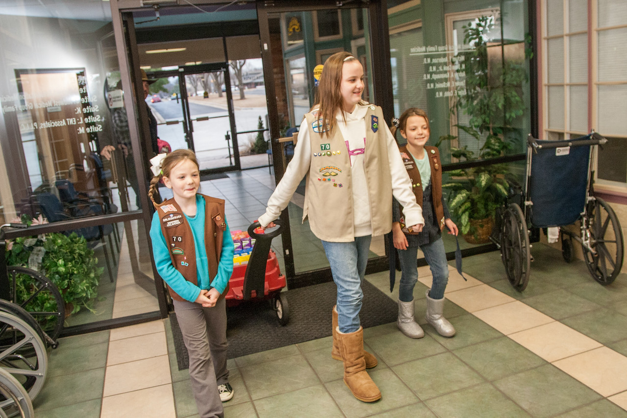 Sisters Layla, Emma, and Marina King selling Girl Scout cookies in Midwest City, OK.