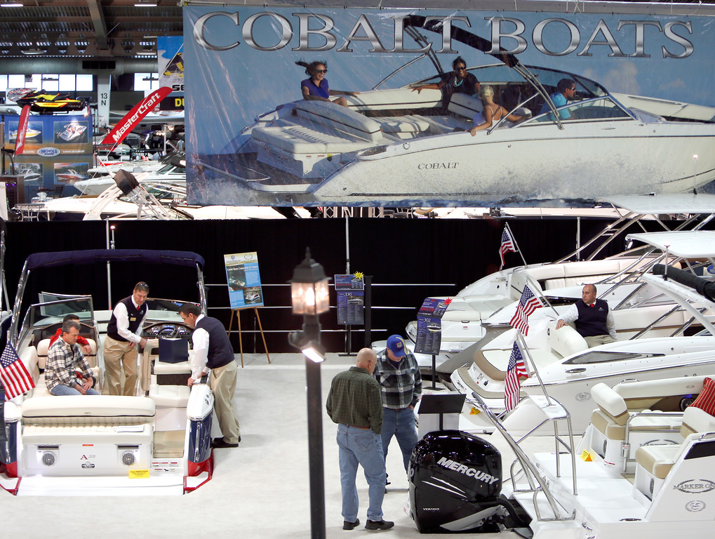 Spectators look at boats on display at the 2015 Tulsa Boat Sport & Travel Show.