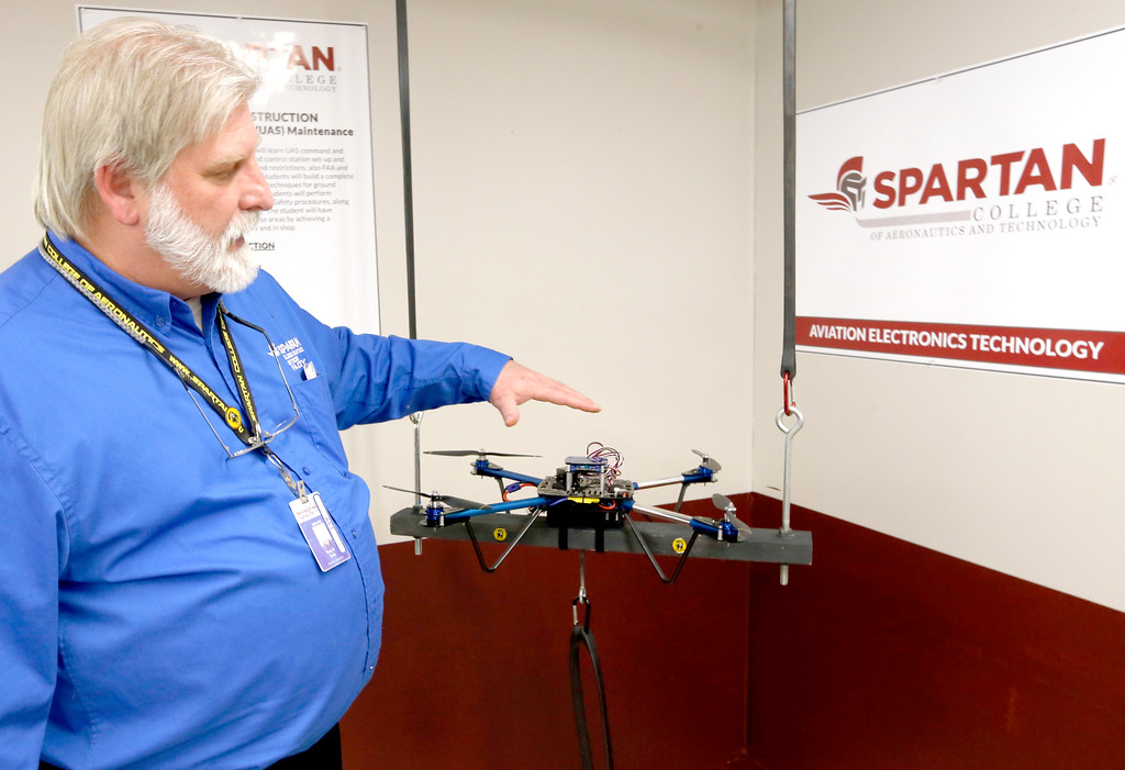 Paul Wells, Instructor at Spartan College of Aeronautics in Tulsa, flies a tethered Unmanned Aerial Vehicle during a press conference announcing a new curriculum centered around maintenance of the UAV's.