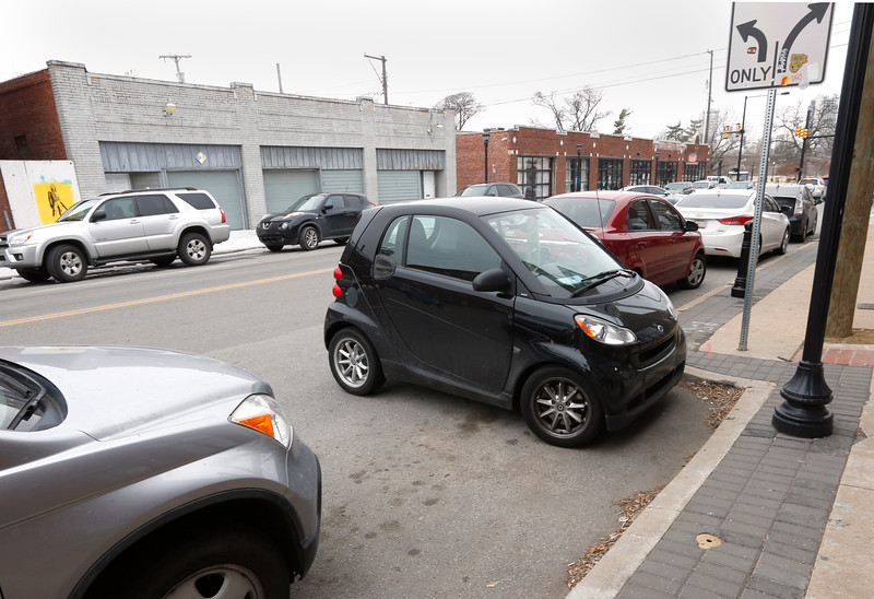 Parking isn't a problem in the Pearl District for the owner of a smart car who used a small variation in the sidewalk to  fit his car into.