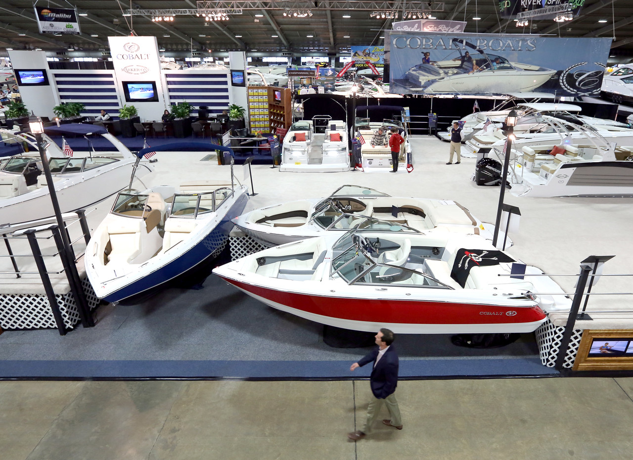 A spectator walks past boats on display at the 2015 Tulsa Boat Sport & Travel Show.