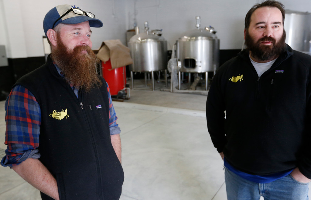 Mason Beecroft and Tony Peck, business partners in Dead Armadillo Brewery, discuss preparations needed to open their brewery.