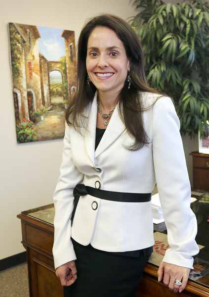 Carey Baker, President  of ProRecruiters, pauses for a photo at her midtown Tulsa office president.