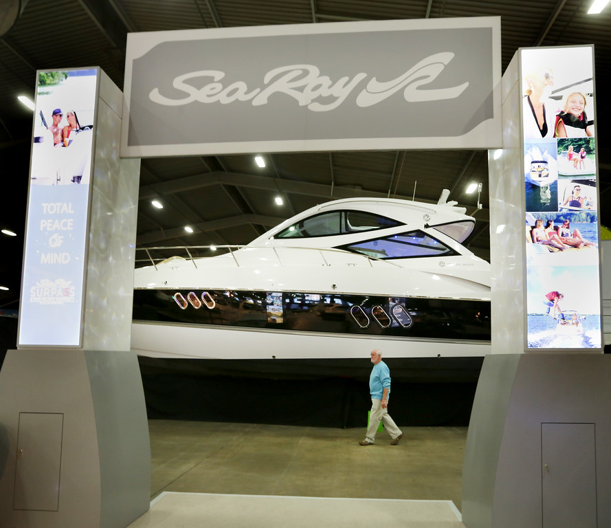 A spectator walks past a $1.7 Million yacht on display at the 2015 Tulsa Boat Sport & Travel Show.