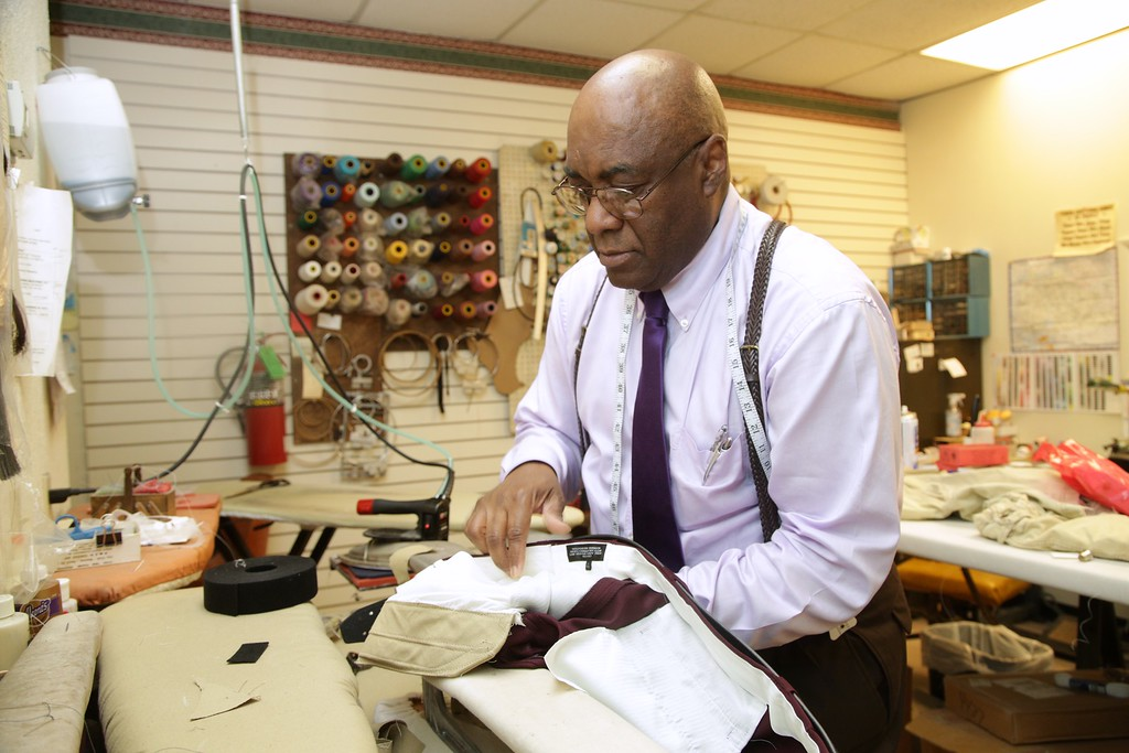 Charles E. Woods altering a pair of slacks for a customer at Sir Charles the Tailer located at 1200 S Air Depot in Midwest City, OK.