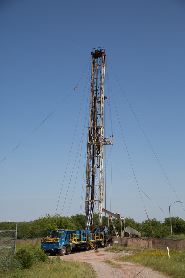 A worker over rig located at Sooner Road and SE 34th Street in Moore, OK operated by Grand Resources Inc.