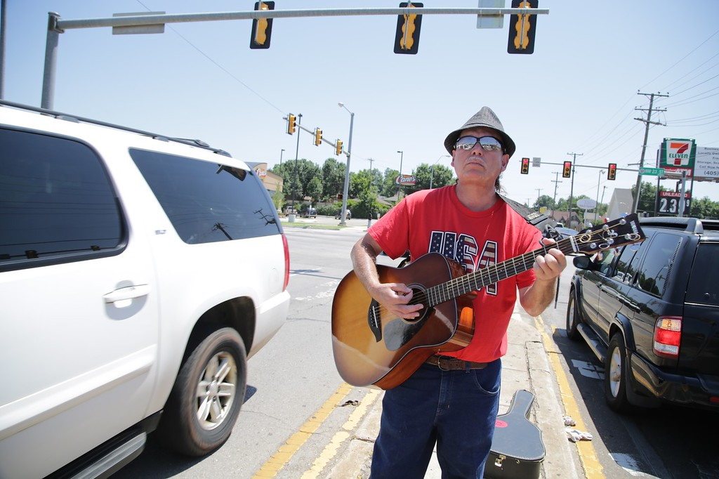 Ruben Cantu playing guitar at the intersection of NW 23rd Street and Pennsylvania Ave in Oklahoma City, OK.