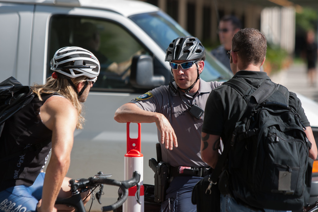 A police officer talking to people during a visit from the president in downtown Oklahoma City, OK.