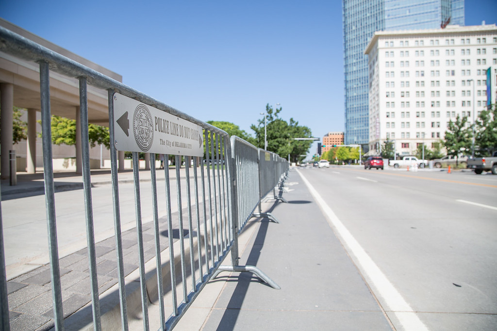 Police barricades in placed on Shariden Ave in Oklahoma City in advance of a visit from President Obama.
