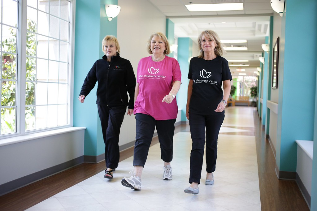 DeVonna Forsberg, Darlene Jonas and Sharon Compton walk the halls together at The Children's Place in Bethany, OK.
