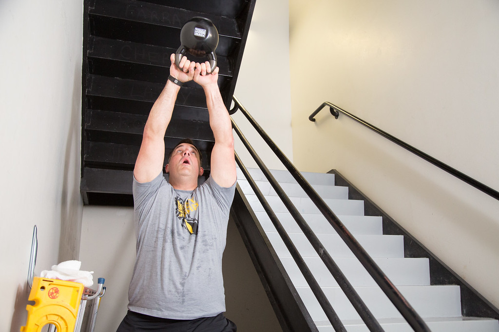 Continental Resources employee Kyle Smith's work out includes climbing up the stairs with a cattle bell.