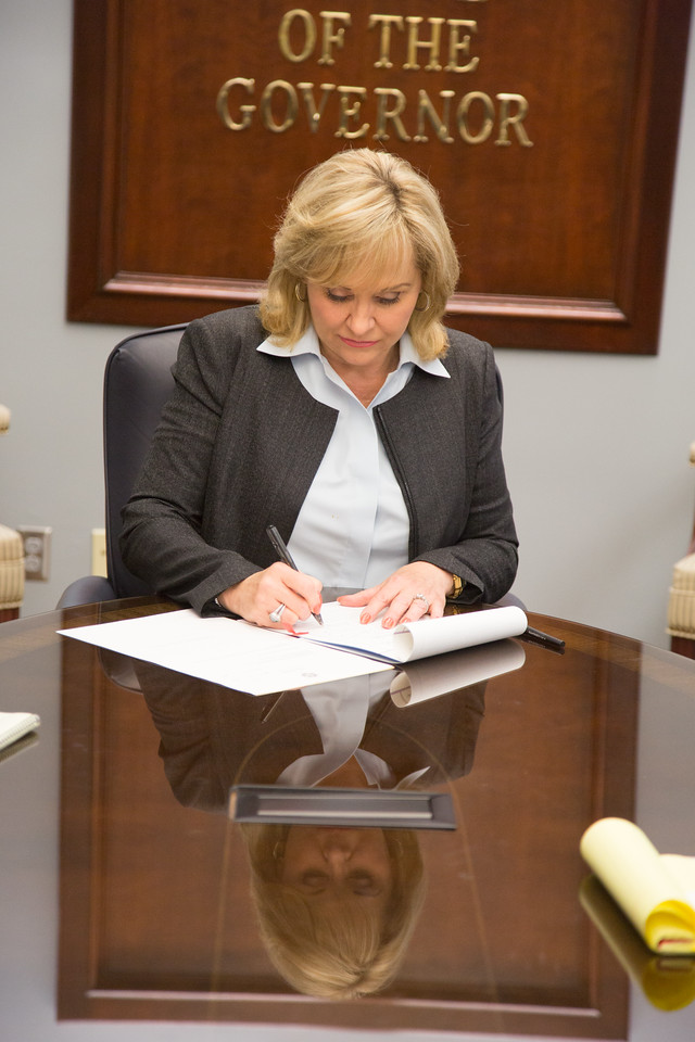 Gov Mary Fallin signing bills passed by the Oklahoma State Legislators into law.