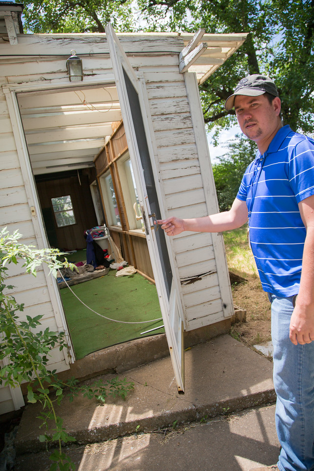 Brandon Williams, code inspector for the City of Oklahoma City, at a vacent home that has been broken into and will be repaired by the city.