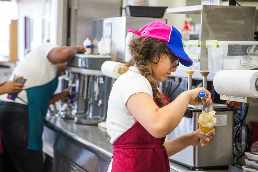 Hajar Blaatifi making a vinella ice cream cone at Braums Dairy Store at 4020 N Penn in Oklahoma City, OK.