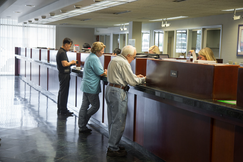 Weokie Credit Union customers making transactions tellers at 8100 W Reno in Oklahoma CIty, OK.