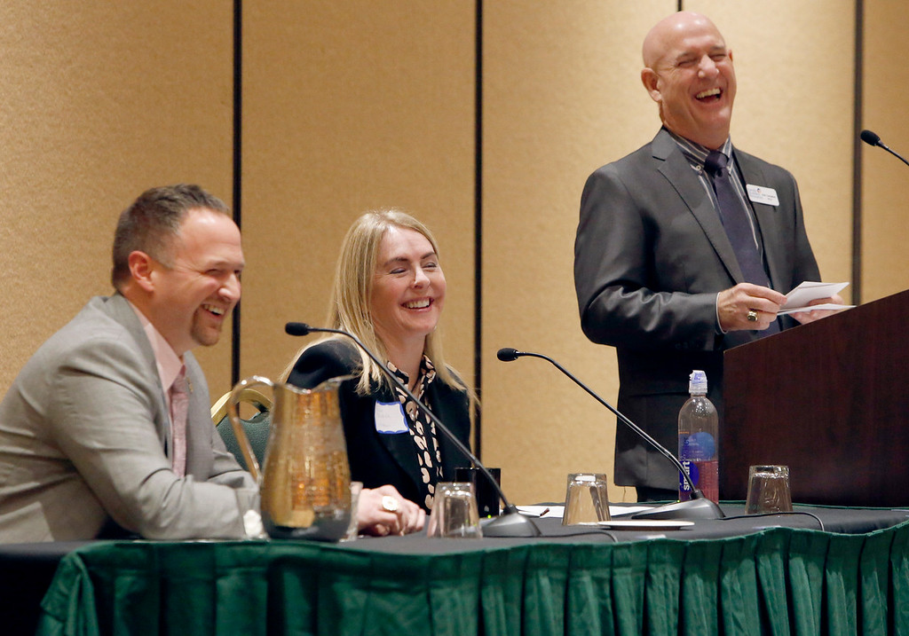 Joel Wildand (J David Jewelry) and Dana Weber (Webco) and Moderator Alan Cambell share a laugh during the Family Business panel discussion at the Tulsa Family Business Forum Tuesday.