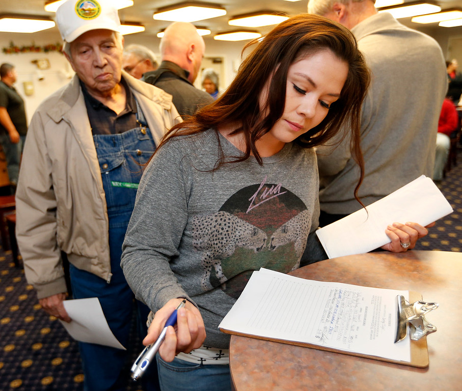 Shannon Nichols (right) signs a petition to seeking remove Principle Chief of the Muscogee (Creek) Nation George Tiger from office.