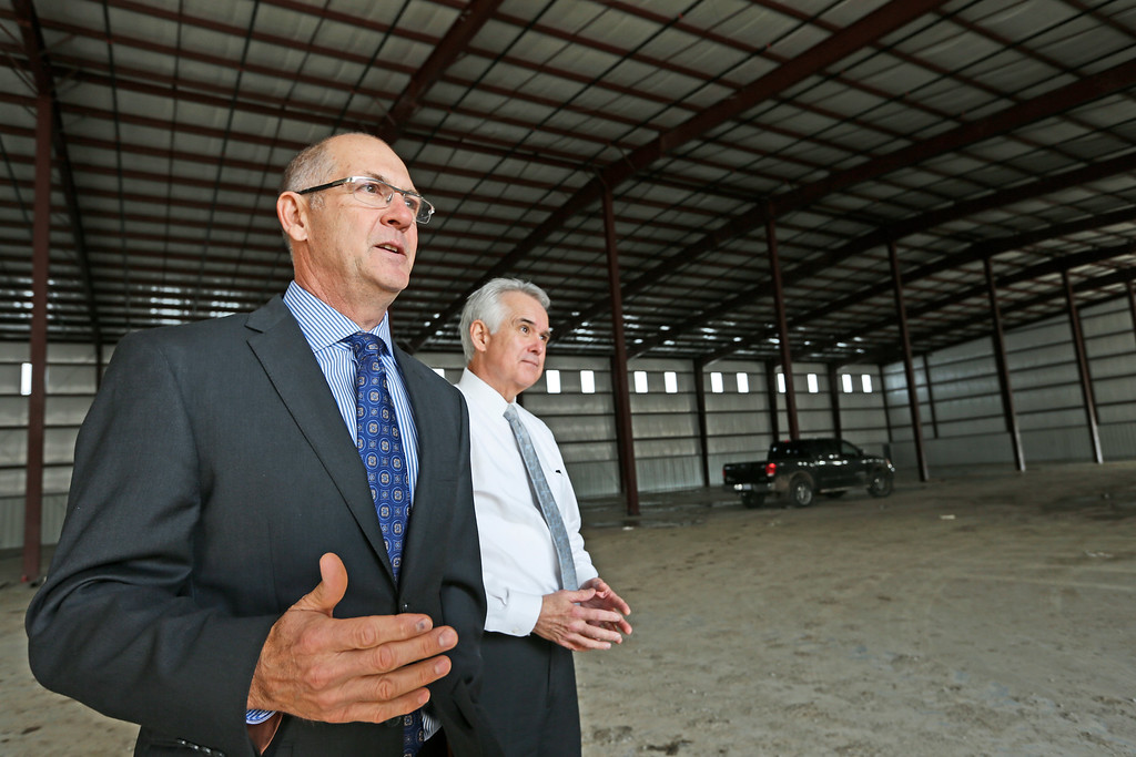 MidAmerica Industrial Parks David R. Stewart, chief administrative officer and Ted Allison, director of economic development inspect a spec built building being constructed at the park.