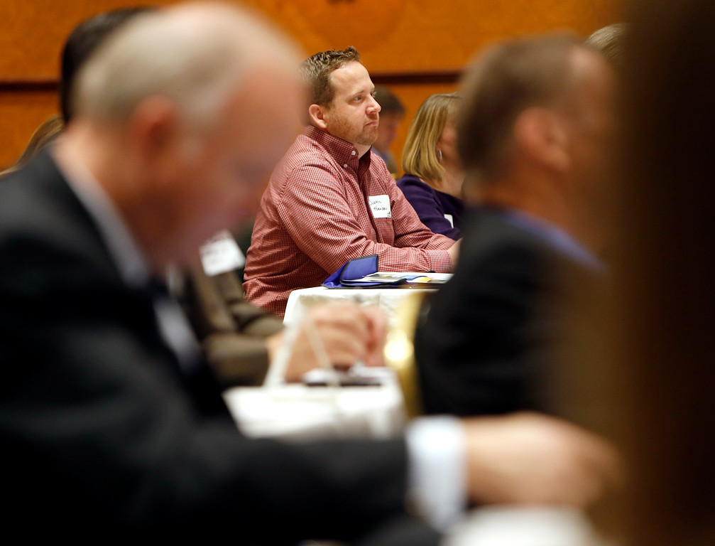 Dusstin Hansel listens to Lawrence Yun, Chief Economist and Senior Vice President of Research at the National Association of Realtors, gives his presentation at the 2015 Greater Tulsa Commercial Market Update seminar.