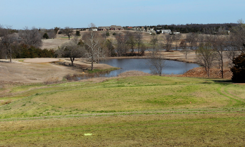 The Sixth hole on the Cushing Country Club.<br /> <br /> Elevated T-box and green to the left of the water hazard.