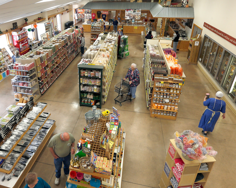 Customers shop at the Amish Cheese House in Chouteau.