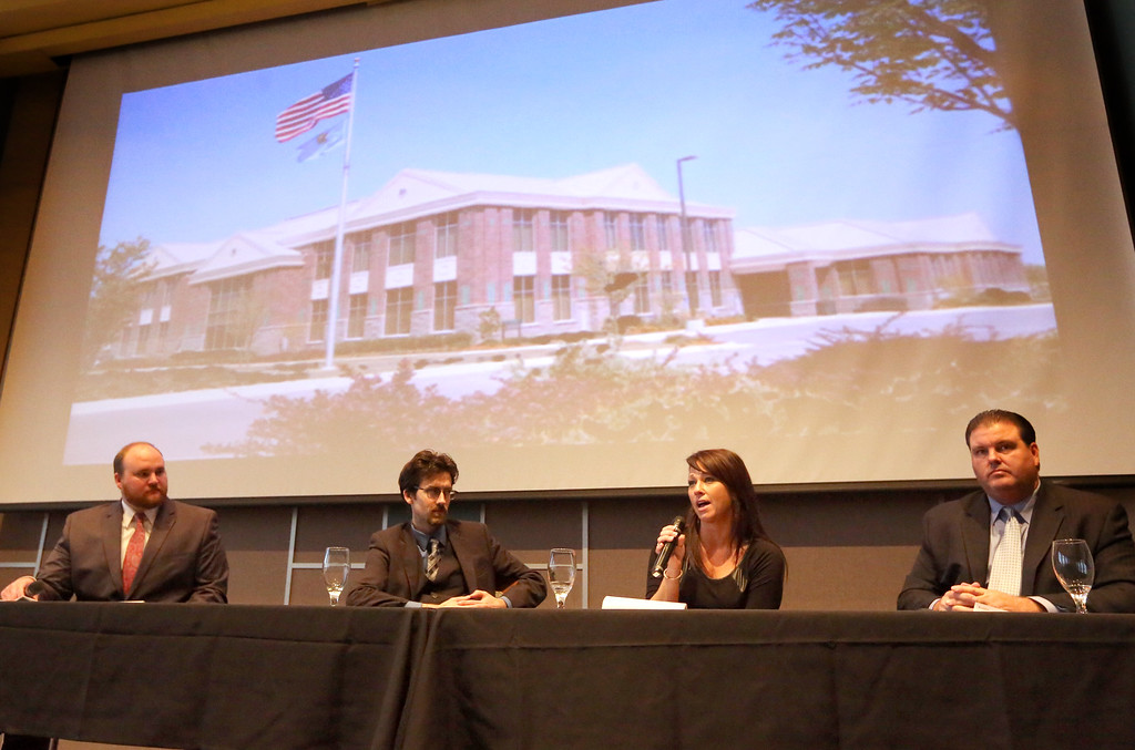 During the Owasso Economic Summit Bronce Stephenson, Warren Unsicker, Angela McLaughlin and Matt Hamrick answer audience question during a panel discussion on downtown development.