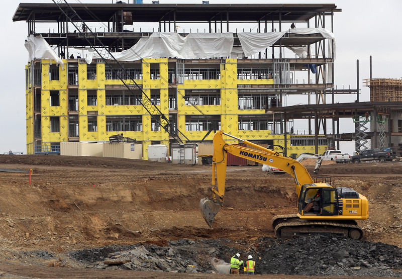 Crossland Construction crews work on Unit Corp.'s 196,400-square-foot office building construction project at the southwest corner of 81st and U.S. Highway 75 in Tulsa.