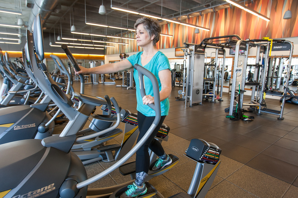 Devon employee Linda Stokes working out at the company gym The Well.